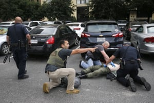 Dallas, USMembers of the Department of Homeland Security and the U.S. Marshal's Service tend to the downed shooter after shots were fired at the Earle Cabell federal courthouse. Law enforcement returned fire and the shooter was hit by gunfire and was pronounced dead at a hospital following the shooting