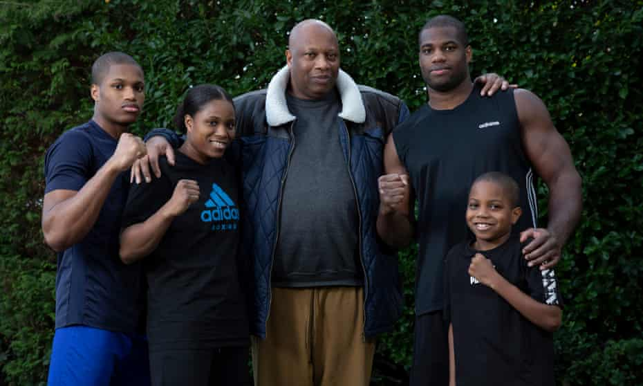 Daniel Dubois, the British heavyweight boxer, poses for a family portrait with his father Dave (centre), sister Caroline and brothers Prince (left) and Solomon (right) in the back garden of their home in Essex