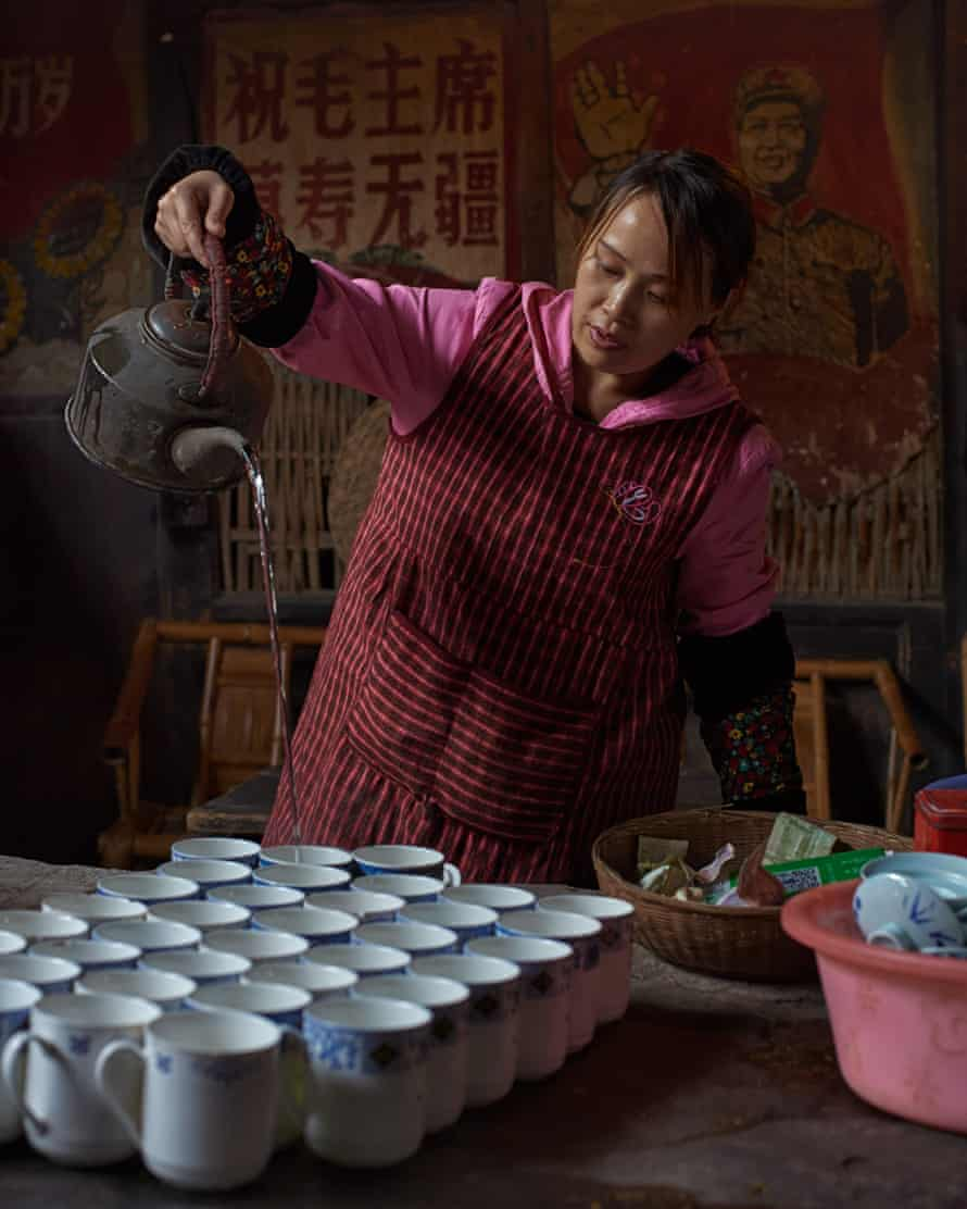 A tea server pours boiling water from a height to extract maximum flavour from jasmine green tea. As is customary in Sichuan teahouses, jasmine tea is the only beverage for sale, China