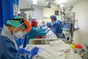 A team of medics proning a patient in ITU.