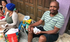 Valdir de Souza, 72, retired, was first in line when the Happy Little Angel project in Rio opened for its weekly food handouts.