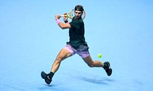 Rafael Nadal hits a backhand.