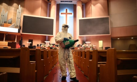 A worker sprays antiseptic solution at the Yoido Full Gospel Church in Seoul, South Korea.