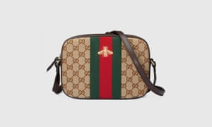 Gucci's GG canvas shoulder bag, with bee.