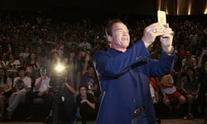 Revival meeting … Arnold Schwarzenegger takes a selfie at the first screenings of Terminator Genisys in Shanghai, China.