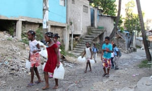Children in a low-income neighborhood of Santo Domingo, in the Dominican Republic, carry containers for water as Hurricane Irma slammed across islands in the northern Caribbean