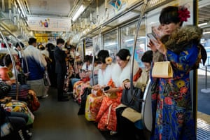 People in traditional attire on the train on Japan's Coming of Age Day, held on the second Monday in January
