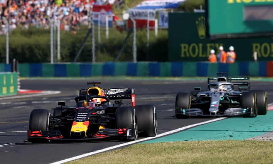 Max Verstappen tries to keep Lewis Hamilton at bay in Hungary.