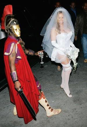 2004 Mariah Carey as a bride and Sean Combs as a trojan