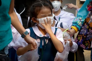 Bangkok, Thailand. A schoolgirl wears a face mask as heavy air pollution continues to affect the city