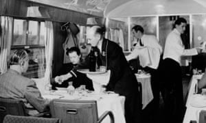 British Railways stewards serving drinks in the First Class dining car, 1951.