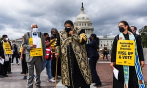 Reverend William Barber II, center, leads leaders of various faiths gathered near the US Capitol and march silently to the supreme court and towards the Dirksen Senate office building to remember Ruth Bader Ginsburg and Kentucky police shooting victim Breonna Taylor. They urged Americans to vote in their memory.