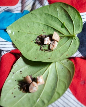Amirjaan makes betel leaf for herself at home.