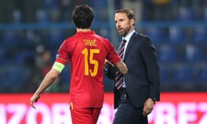 Gareth Southgate speaks to Montenegro captain Stefan Savic on the final whistle.