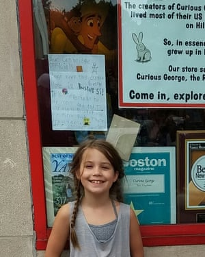 Vanessa Tavares, 8, a Curious George fan whose letter calling for the store to be saved is taped to the shop window