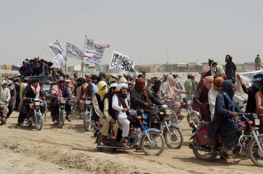Men on motorbikes with Taliban flags crossing the Pakistan-Afghanistan border at Chaman, Balochistan.