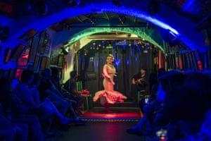 Granada: A flamenco dancer performs behind plastic, as a protective measure against the coronavirus
