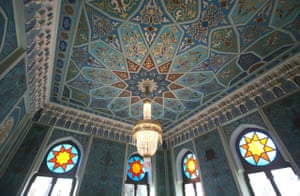 Ceiling and stained glass detailing inside.