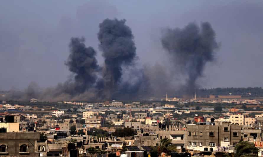 Smoke rises over buildings in Rafah
