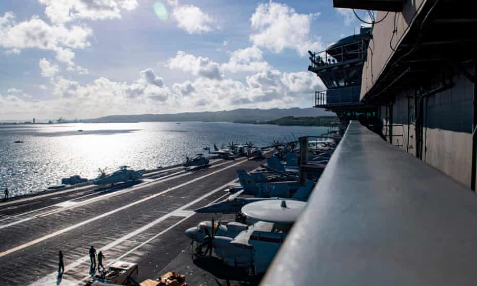 The island of Guam seen from the deck of the USS Theodore Roosevelt. The relationship between the US navy and the islands of Guam and the Northern Marianas are generally strong, but strained over the issue of environmental damage.
