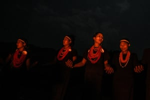 Dressed in black and wearing orange bead necklaces and palm leaf headbands, they rotate around a fire in Satpalaw Shaung village, hands held tightly and braving the cold with bare arms.