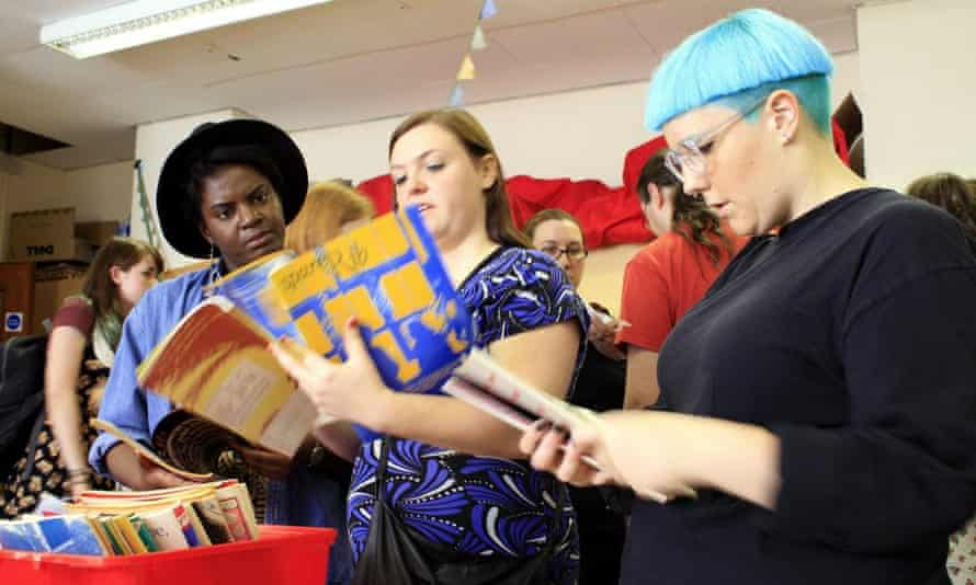Three women reading Spare Rib at the Feminist Library in London.