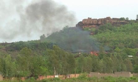Flames rise following an attack where gunmen stormed Le Campement Kangaba resort in Dougourakoro, to the east of the Malian capital Bamako.