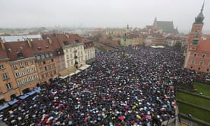 Thousands hold umbrellas in Warsaw during a nationwide strike to protest against a legislative proposal for a total ban on abortion in Poland