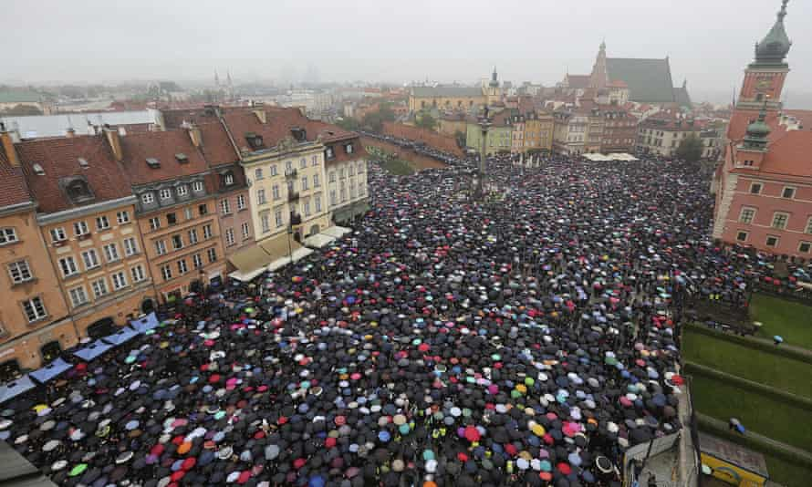 Thousands hold umbrellas in Warsaw during a nationwide strike to protest a near total ban on abortion.