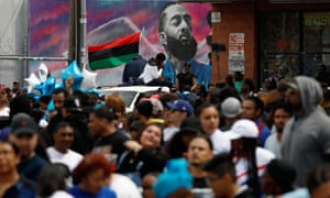 Fans wait for the funeral procession following a memorial for Nipsey Hussle along Slauson Avenue in Los Angeles on 11 April.