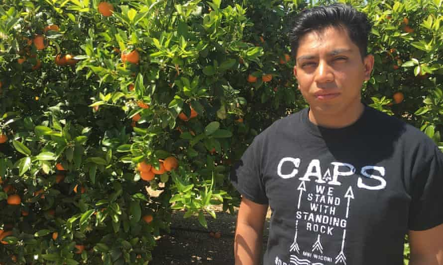 Angel Garcia by an orange grove in Tulare County