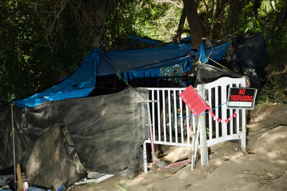 A homeless encampment sits near the banks of Coyote Creek.