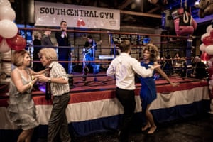 Dancers dance next to a boxing ring at The Duce, Phoenix, Arizona, US.
