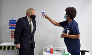 Boris Johnson having his temperature checked during a visit to Chase Farm Hospital in north London this morning.
