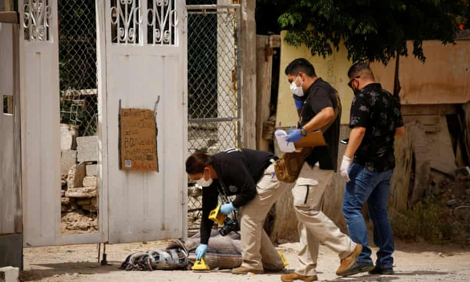 Forensic investigators work at a scene where assailants left a package and a threat message taped to the gate of the house of Leticia Castillo, a candidate of the Social Encounter party (PES) for the local congress, in Ciudad Juárez last week.