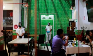 Acrylic separating walls for social distancing are pictured at Los ponchos restaurant during the start of the gradual reopening of commercial activities in Mexico City, Mexico 4 July 2020.