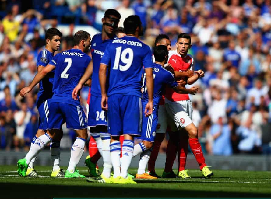 Gabriel is restrained by his Arsenal team-mates after his red card, as Diego Costa watches on.