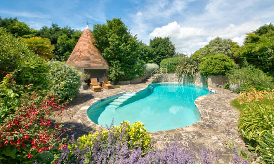 Pool surrounded by flowering plants at  Shalfleet Manor EstateIsle of Wight.