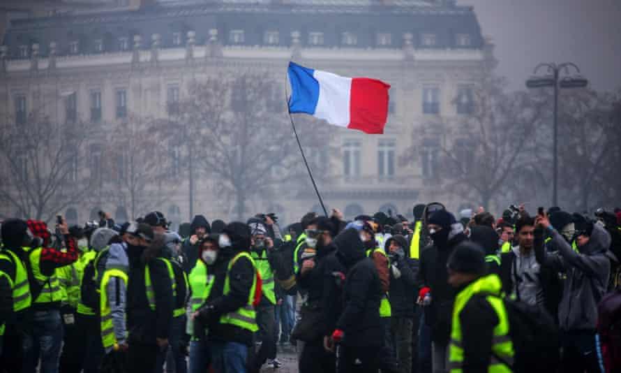 Demonstrators gather near the Arc de Triomphe