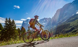 Young woman cycling mountain road in Switzerland