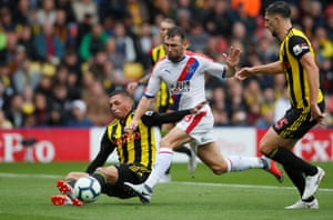 Watford's José Holebas gets his foot to the ball to halt Crystal Palace's James McArthur getting off a clean shot as The Hornets win 2-1 at Vicarage Road. Watford have won their opening three games of a top-flight league campaign for the first time in their history.