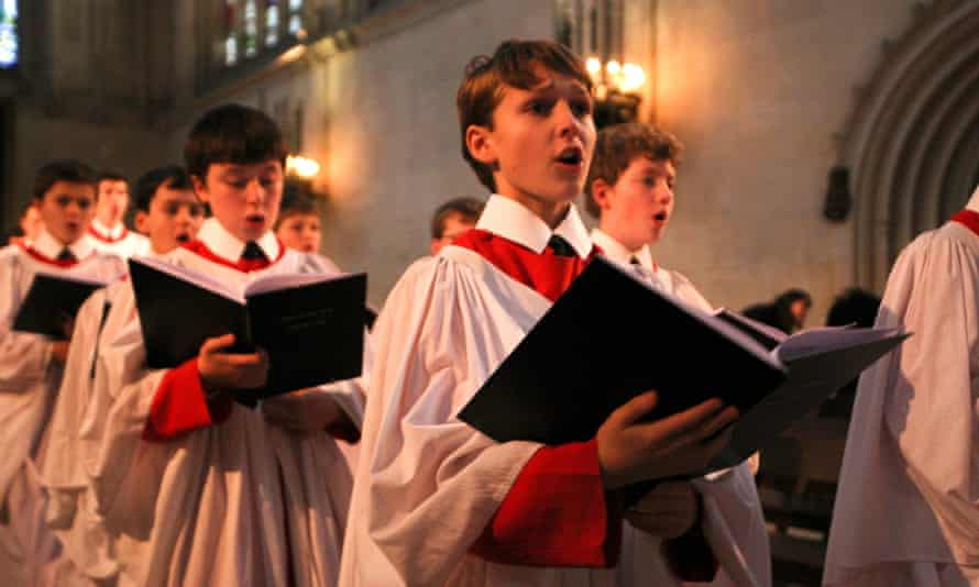 Members of King's College choir prepare for a final rehearsal before the recording of their famous A Festival of Nine Lessons and Carols service.