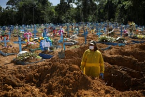 A gravedigger works at the Parque Taruma cemetery amid the coronavirus outbreak in Manau, one of the worst in the country.