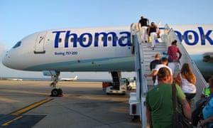 Passengers board a Thomas Cook flight