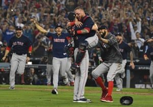 Boston Red Sox pitcher Chris Sale celebrates with teammates including catcher Christian Vazquez and pitcher David Price after defeating the Los Angeles Dodgers at Dodger Stadium in Los Angeles