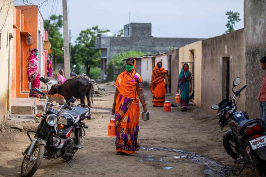 Dairy farmers arrive to deposit milk at Lakshmi Dairy in Karajgaon, in Latur District, Maharshtra, October 2020