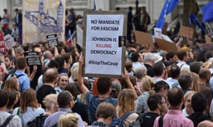 Protesters gather outside the gates of Downing Street in opposition to Boris Johnson's decision to prorogue parliament