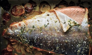 Baked salmon with thyme and thin potatoes.