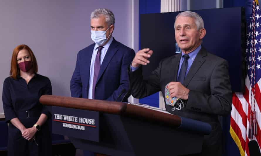 Left to right: White House press secretary Jen Psaki, Covid response coordinator Jeff Zients and Dr Anthony Fauci brief reporters on 13 April 2021 in Washington.