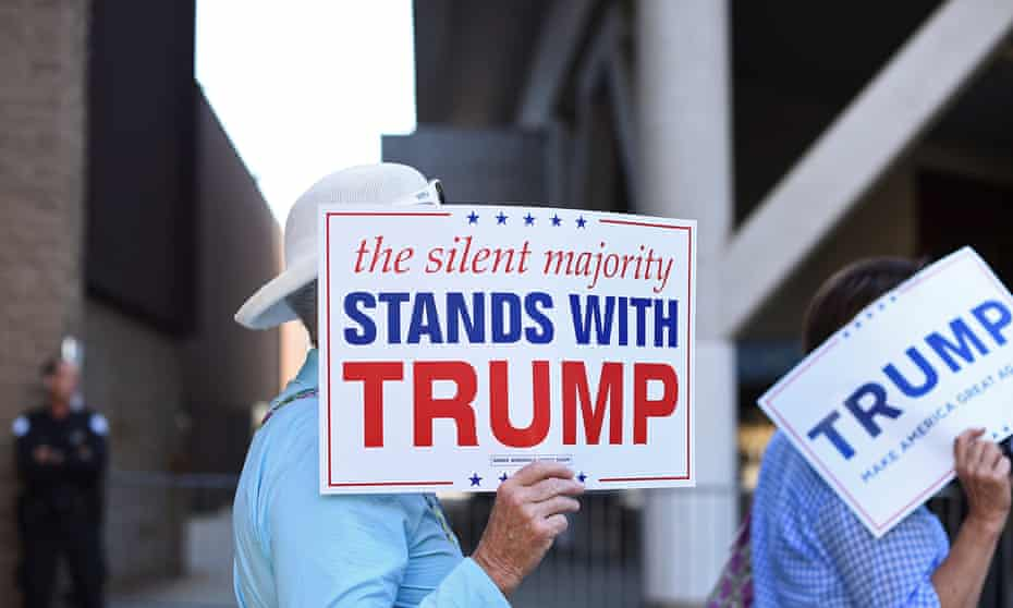 women enter trump rally with 'silent majority signs'